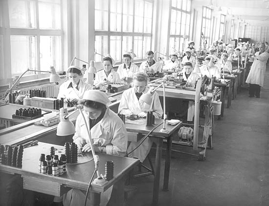 Section of the assembly line of photographic lenses at KMZ, 1956